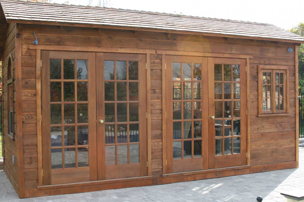 Cedar Bar Harbor spa enclosure plan 8x18 with French double doors in the yard as seen from the front. ID number 1537.