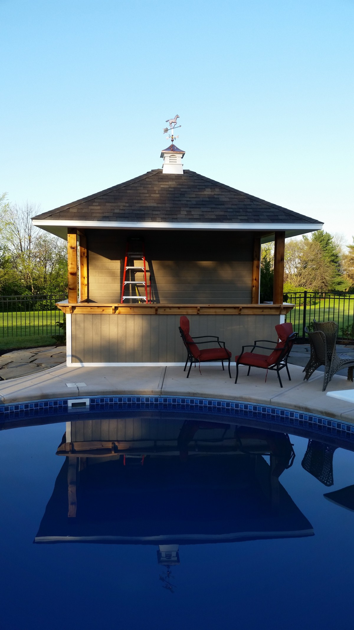 Surfside pool house design 10x12 with a cupola side profile by a poolside seen from the front2. ID number