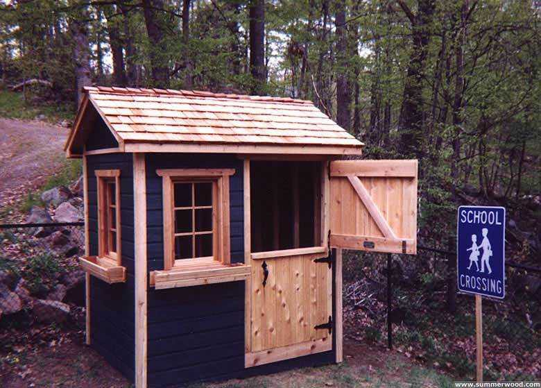 Bear club playhouse design 5  x  7 in backyard with  opening windows seen from front.ID number 2799-3.