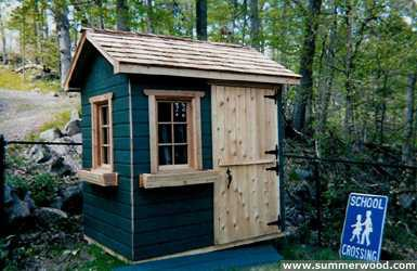 Bear club playhouse design 5  x  7 in backyard with  opening windows seen from front.ID number 2799-2.