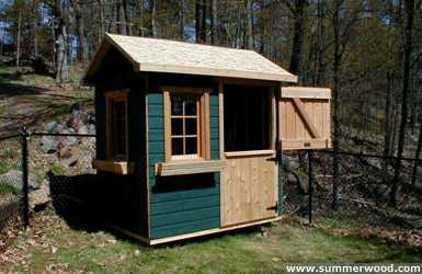 Bear club playhouse design 5  x  7 in backyard with  opening windows seen from front.ID number 2799-4.