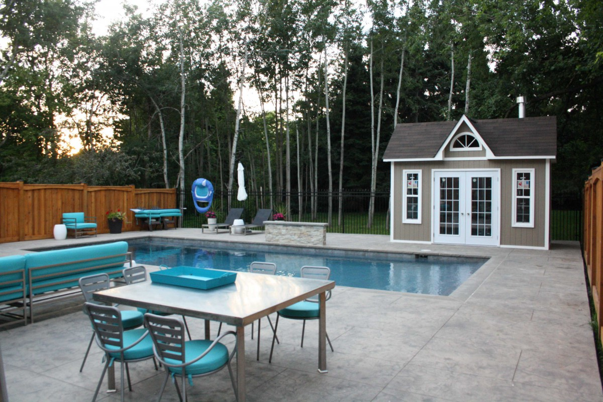 Copper creek pool cabana design 8 x 14 with metal French double doors in a backyard seen from the far front. ID number 1845-2.