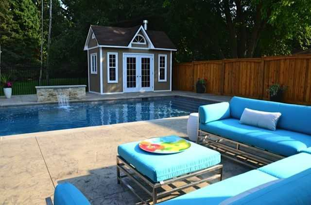 Copper creek pool cabana design 8 x 14 with metal French double doors in a backyard seen from the left. ID number 1845-1.