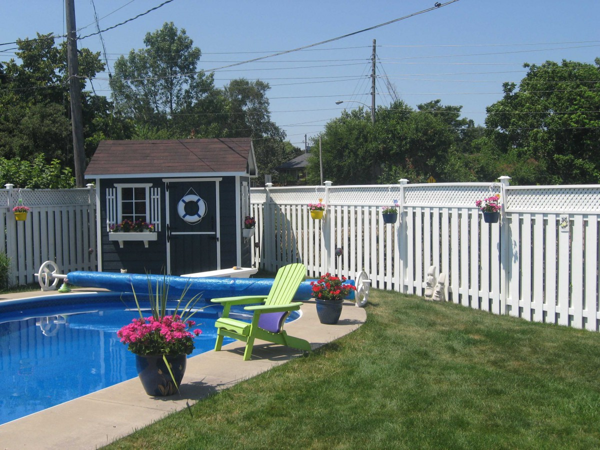 Palmerston pool house plan 6 x 9 with a single Dutch door by a poolside seen from the far. ID number 2729-3.