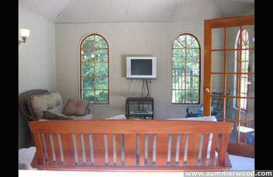 Sonoma pool cabana design 5 x 10 with pane arched windows by a poolside seen from the inside. ID number 3300-5.