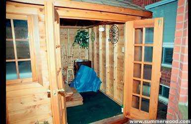 Sojo hot tub enclosure plan 8  x  12 in backyard with opening windows seen from inside.ID number 3345-3.