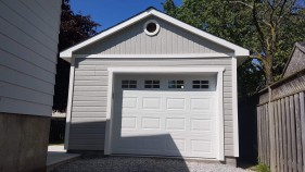 Backyard Canexel Highlands Garage Plan 14' x 24' with steel insulated garage door in the front. ID number 5730-1.