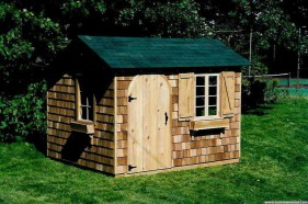 Bar harbor shed plan 8 x 10 in a yard with double casement seen from the left. ID number 1505