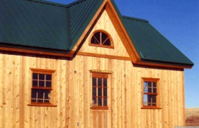 Cedar breckenridge cabin design 14x24 with deluxe single door outdoor seen from the side. ID number 2839-33.