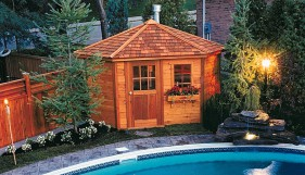 Catalina pool house plan 11 ft with a cedar siding by a pool seen from the front. ID number 2976-1.