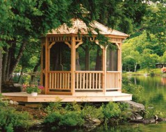 Monterey gazebo design 8' beside a lake with natural finish seen from front.ID number 3123-1.