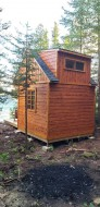 Cedar Balabunkie rustic cabin plan 10' x 10' facing ocean with French lite double doors as seen from the front. ID number 5724-1