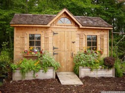 Palmerston shed design 7 x 15 with a Dutch door and a ramp in a garden seen from the front. ID number 2202-2.