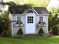 Palmerston shed plan 8 x 12 with a deluxe door in a yard seen from the front. ID number 2287-3.