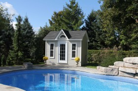 Canexel Copper Creek pool house design 9x12 with dormer beside a pool as seen from the frontage. ID number 3040-212.
