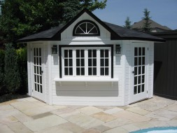 Catalina pool house design 10 ft with a fan arch window by a poolside seen from the front. ID number 3324-1.
