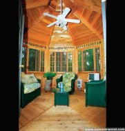 Cedar San Cristobel pool cabana design 12x16 with double doors in a backyard seen from the right. ID number 3047-104.