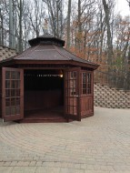 San CriSan cristobal gazebo design 16' before woods with weathervanes seen from front.ID number 3133-1.