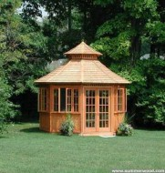 San cristobal gazebo design 14' in backyard with stained finish seen from front.ID number 3418-1.