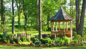 Tattle creek gazebo design 8' in garden with natural finish seen from front.ID number 2833-2.