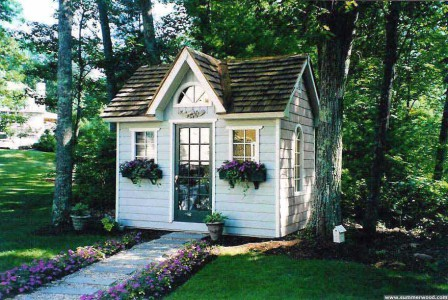 Copper creek shed design 8 x 12 with a French door in a garden seen from the right. ID number 2974-1.