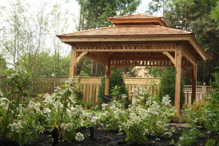 Garden Montpellier gazebo plan 12ft in a backyard seen from the front. ID number 2955-199.