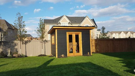 Backyard urban studio home studio plan 9'x12' in a backyard seen from the front 2. ID number 5708-1.