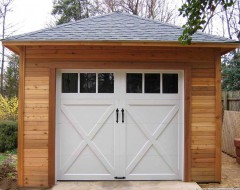 Archer garage plan 20 x 24 in driveway with metal doors seen from back.ID number 3351-2.