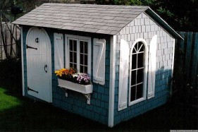 Bar harbor shed design 8 x 10 in a yard with pane arch seen from the right. ID number 1499