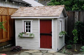 Bear club playhouse design 5  x  7 in backyard with  opening windows  seen from front.ID number 3272-1.