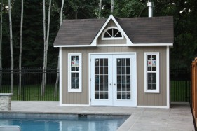 Copper creek pool cabana design 8 x 14 with metal French double doors in a backyard seen from the front. ID number 1845-3.
