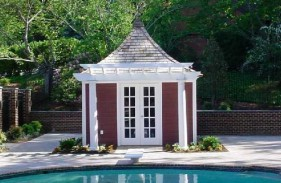 Canexel Melbourne pool cabana design 12x12 with French double doors by the pool seen from the front. ID number 3026-103.