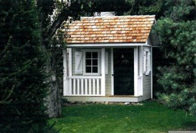 Cedar Peach Pickers Porch playhouse plan 7x7 with flower box in the garden. ID number 2801-206.