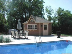 Catalina pool cabana design 14 ft with a medium bifold window by a poolside seen from the front. ID number 3306-2. poolside catalina pool cabana design front 3306-2