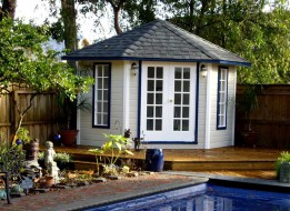 Catalina pool cabana design 9 ft with French double doors by a pool seen from the front. ID number 3320-1.