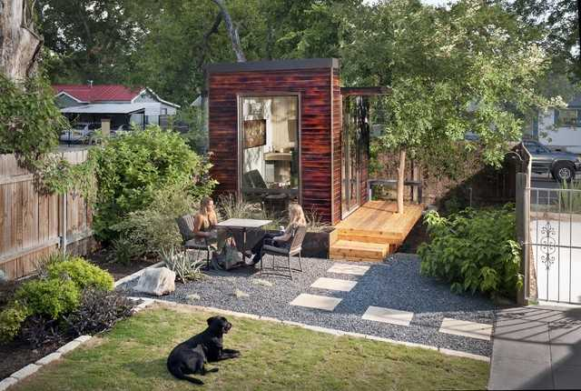This backyard studio plan used large glass and a modern wood finish.