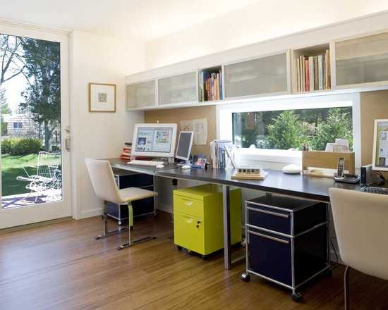 This backyard office studio allowed maximum use of space by keeping the desks against a wall.